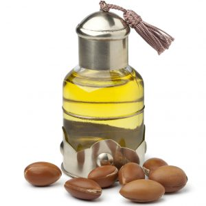 21859879 - bottle of moroccan cosmetic argan oil and nuts